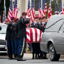 Pallbearers prepare to move the casket of Army Spc. Brian Arsenault into the St. Rose of Lima Parish in Northborough on Sept. 16, 2014.