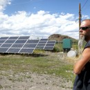 In Del Norte, Colo., Public Works Supervisor Kevin Larimore shows off solar panels that provide electricity for the town's water supply. Despite generating its own solar energy, the town is still at risk of a blackout if its main power line goes down.