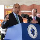 Massachusetts Governor Deval Patrick, at an October 2014 press conference at the former Westinghouse plant in Springfield, where he announced that CNR will build a plant to assemble subway cars.