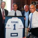 Springfield Mayor Domenic J. Sarno, second from left, meets at City Hall with, from left, Suffolk Construction Chief executive officer John Fish, Springfield Superintendent of Schools Daniel Warwick, and former Boston Mayor Thomas Menino. They met to discuss the planned expansion of the Boston Scholar Athletes program to Putnam Vocational Technical Academy. The Boston guests presented Sarno with a soccer jersey.