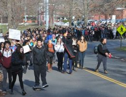 Hundreds of students walked out of Amherst Regional High and marched to downtown Amherst to protest recent events in Ferguson, MO., and New York City.