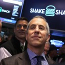 Founder and chairman of Shake Shack, Danny Meyer, visits the floor of the New York Stock Exchange. As trading began Friday, the hamburger chain's shares jumped from $21 to $50.