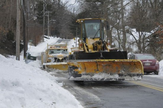 Snow plowing on Prospect St. East Longmeadow, Mass., as winter storm Juno moves out of the area Tuesday afternoon, January 27, 2015.
