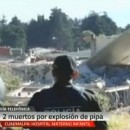 In this video frame grab image taken from Milenio TV via APTN, police look at the scene where a gas tank truck exploded outside a maternity and children's hospital in Mexico City on Thursday.
