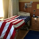 A hospital bed is draped with a flag after a veteran passed away at the hospice ward at St. Albans VA in Queens, N.Y.