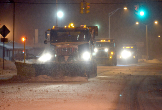 Plows attack Memorial Drive in Chicopee, Mass., as winter storm Juno arrives on Jan. 26, 2015.