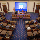 At the center of the Edward M. Kennedy Institute is a replica of the U.S. Senate chamber — a majestic room with gilded wallpaper and wooden desks modeled off the original congressional furniture.
