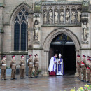 The Archbishop of Canterbury Justin Welby waits at the entrance to Leicester cathedral where the re-interment ceremony of Richard III was held Thursday.