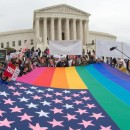 Protesters hold a pro-gay rights flag outside the US Supreme Court on Saturday, countering the demonstrators who attended the March For Marriage in Washington, DC. The Supreme Court meets on Tuesday to hear arguments whether same-sex couples have a constitutional right to wed in the United States, with a final decision expected in June.