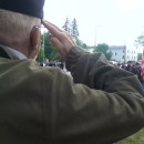 Veteran William Streeter salutes a flag in the Northampton, Massachusetts, Memorial Day parade.
