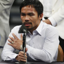 Manny Pacquiao answers questions May 2 during a news conference following his welterweight title fight against Floyd Mayweather Jr. in Las Vegas. Pacquiao could face disciplinary action from Nevada boxing officials for failing to disclose a shoulder injury before the fight.