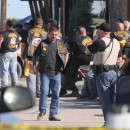 Authorities investigate a shooting in the parking lot of the Twin Peaks restaurant Sunday in Waco, Texas. Bikers say that most of the 170 people arrested had nothing to do with the violence.