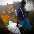 Health workers collect the body of a cholera victim in Petionville, Haiti, February 2011. The cholera outbreak in Haiti began in October 2010. Nearly 9,000 people have died.