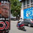 """German Finance Minister Wolfang Schaeuble is depicted on a pro No poster (left) next to a graffiti (right) that read """"No"""" (Nein) in German but also sounds like """"Yes"""" in Greek. The photo was taken in Athens, on Sunday."""