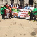 Government officials join members of the Springfield Carnival Association outside of City Hall.