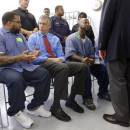 Education Secretary Arne Duncan, second from left, speaks with inmate Terrell Johnson, a participant in the Goucher College Prison Education Partnership.