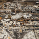 Destroyed homes and vehicles scorched by the Valley Fire line Jefferson Street in Middletown, Calif. Nearly half the community was destroyed.