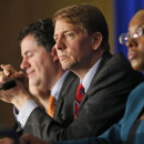 Consumer Financial Protection Bureau Director Richard Cordray, center, participates in a panel discussion in March. His agency is considering banning financial companies from routinely requiring consumers to sign away the right to sue.
