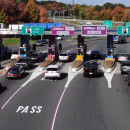 Motorists getting off the Mass Turnpike in West Springfield pull up to pay their toll, as the free tolls in the Western part of the state stopped in October 2013.