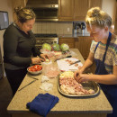 Michelle Aguilar and Allison Lees prepare lunch for the other residents at the Project COPE Women's Residential Program, an inpatient substance abuse treatment program specifically for women.